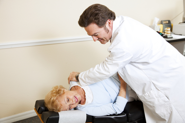 Elderly woman seeing a chiropractor